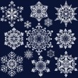Stock Vector: White snowflake ornate shapes isolated on dark blue background.