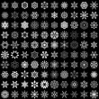 Set of vector snowflakes isolated on black background. 100 snowf — Stock Vector
