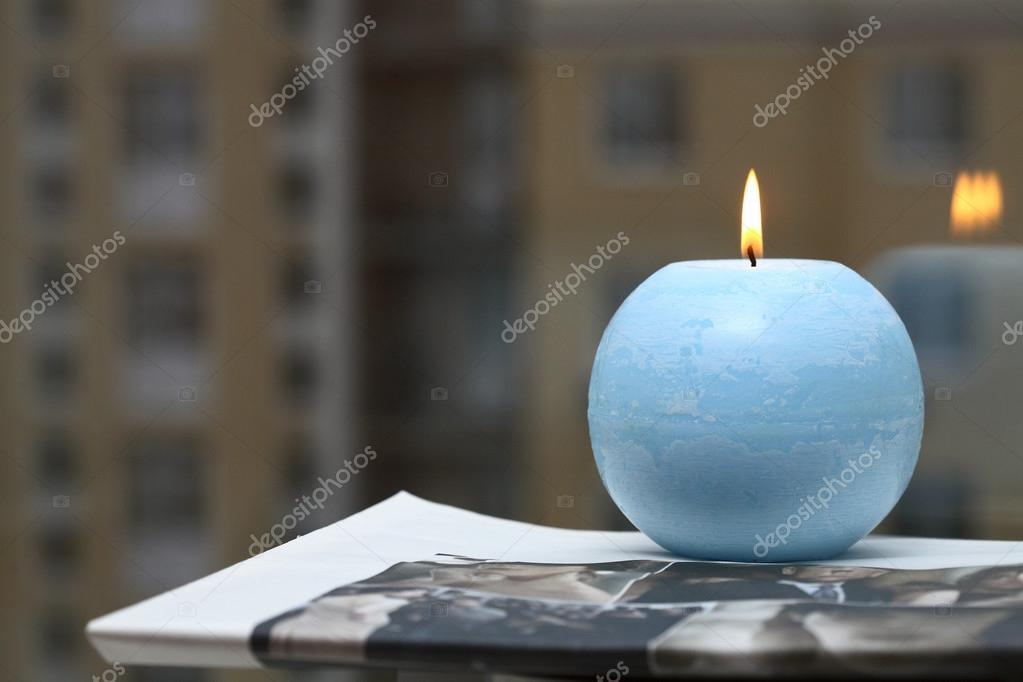 Blue candle and newspaper  Stock Photo #12660305