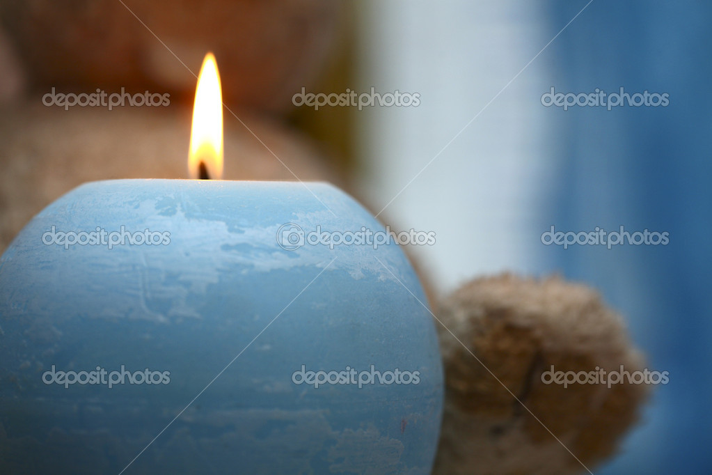 Blue candle and the toy  Stock Photo #12660410