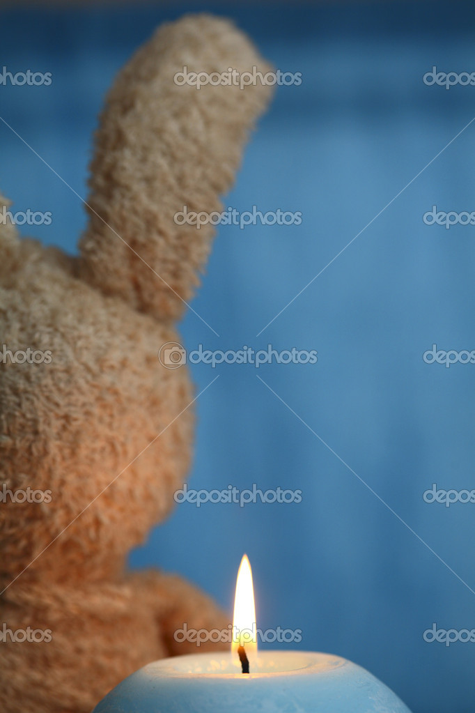 Blue candle and the toy — Stock Photo #12660413