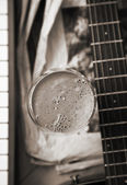 Monochrome image, milk coctail and musical instruments — Stock Photo