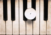 Artwork in grunge style, candle on the piano — Stock Photo