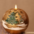 New Year's decoration, golden candle — Stock Photo #34555323