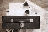 Artwork  in vintage  style, cup of coffee and old suitcase — Photo