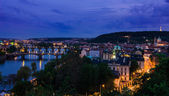 Vltava river and bridges in Prague after sunset — Stock Photo
