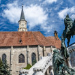 Saint Michael's gothic church and King Mathias — Stock Photo