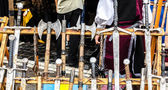 A wooden rack with several medieval weapons — Foto Stock