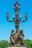 Sculpture cherubs on the bridge Alexander's III — Stock Photo