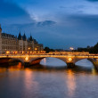 Palais de Justice, night view over the Seine — Stock Photo #49287399
