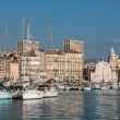 White church and the port of Marseille — Stock Photo #50197151