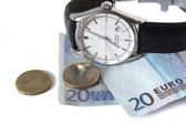 Watch (time) and money — Stock Photo