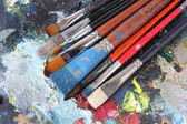 Palette and stained brushes — Stock Photo