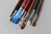 Stained brushes on canvas — Foto de Stock