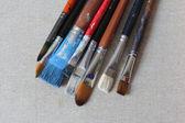 Tinto pennelli su tela — Foto Stock