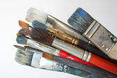 Bunch of stained brushes — Stock Photo