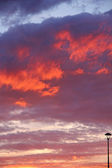 Burning red clouds on the sky — Stock Photo