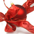 Red christmas bauble and ribbon on white — Stock Photo #15637157