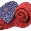 Blue winter cap and red scarf isolated on white background — Stock Photo #16208975
