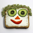 Face on sandwich, funny breakfast for kids — Stock Photo