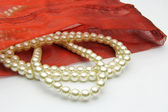 White pearls in red bag — Stock Photo