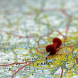 Royalty-Free Stock Photo: Red push pin pointing at Paris, France