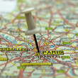 Royalty-Free Stock Photo: White push pin pointing at Paris, France