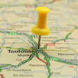 Push pin pointing at Toulouse, France - Stock Photo