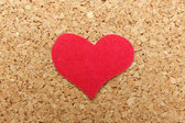 Paper red heart on cork background — Stock Photo