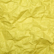Yellow crumpled paper background — Stock Photo #23861345