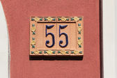 Number fifty-five, house address plate number — Stock Photo