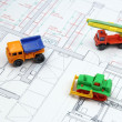 Architectural plans and toy bulldozer, dump truck — Stock Photo
