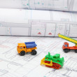 Toy construction equipment on architectural projects — Stock Photo