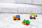 Toy construction equipment on architectural projects — Foto de Stock