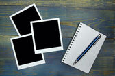 Blank notebook with pen and photo frame on wooden background — Stock Photo