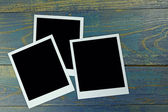 Three photo frame on old wooden background — ストック写真