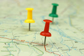 Colorful push pins on a road map — Stock Photo
