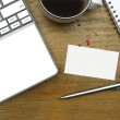 Laptop, coffee, blank business card, pen and notebook on wooden — Stock Photo