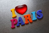I love paris spelled out using colored fridge magnets — Stock Photo