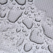 Rain drops on metalic surface — Stock Photo