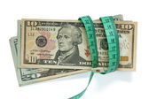 Dollar banknotes and measure tape — Stock Photo