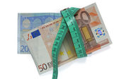 Euro banknotes and measure tape — Stock Photo