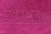 Pink towel with flower pattern — Stock Photo