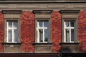 Three windows on brick wall — Stock Photo