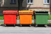 Colorful recycle bins on the street — Stock Photo