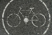 Bicycle road sign painted on the pavement — Stock Photo
