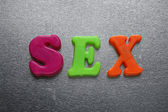 Sex spelled out using colored magnets — Stock Photo