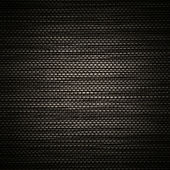 Black background with woven pattern — Stock Photo