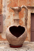 Old greek vase with a heart-shaped whole — Stock Photo