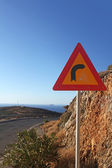 Turn right sign on the mountaing road along the coast - Crete, Greece — Stock Photo
